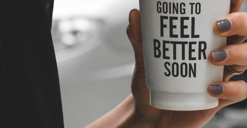 """Holding coffee cup saying """"Going to feel better soon"""""""