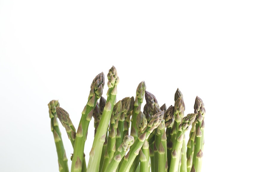 Fresh asparagus with a white background
