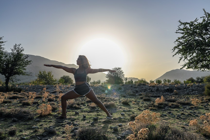 Woman in nature doing yoga